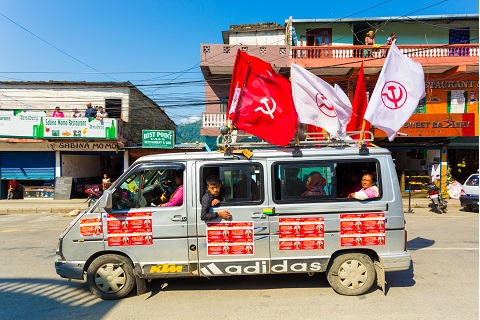picture of a van with communist flags in Nepal